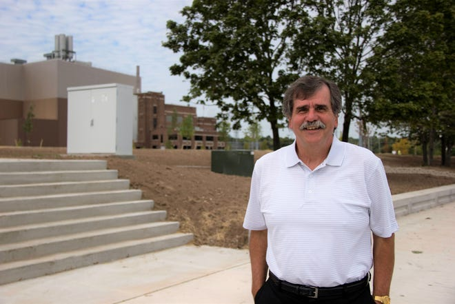 Mark Grams, who recently retired after 33 years as Port Washington's city administrator is pictured on the harbor promenade of Coal Dock Park when it opened in 2013.