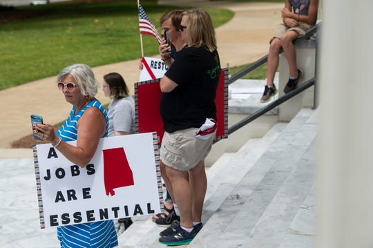 Protestors gather for a 'Stop the Shutdown' protest on the steps of the Alabama State Capitol in Montgomery, Ala., on Tuesday, May 5, 2020.