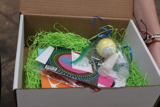 The mental health boxes include a journal, bath bombs, music and other products to give girls and women a boost.