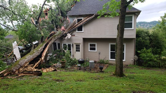 A tree split the roof of a home in Franklin's Fieldstone Farms neighborhood on Monday night as the second round of storms ripped through Williamson County.