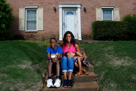 Tamara Henderson, and her children Trey, 11, and Trinity, 5, sit outside their home on Tuesday. Though Henderson was approved for the Tennessee ESA program, a judge declared it unconstitutional, upending her plans to enroll her daughter at the private Arete Christian School.