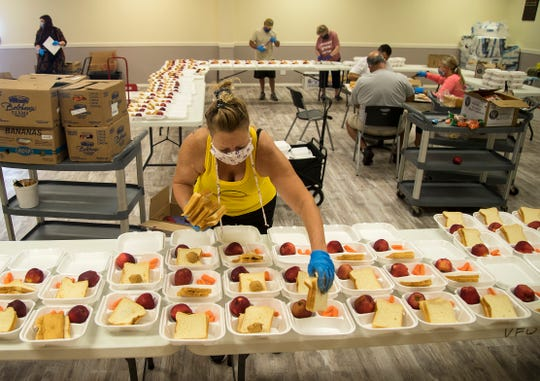Tina Clark and other volunteers make meals to be delivered to families throughout Collier County on Tuesday, May 5, 2020, at the VFW in Naples. Many families receiving the meals live far away from school meal distribution sites or don't have transportation.