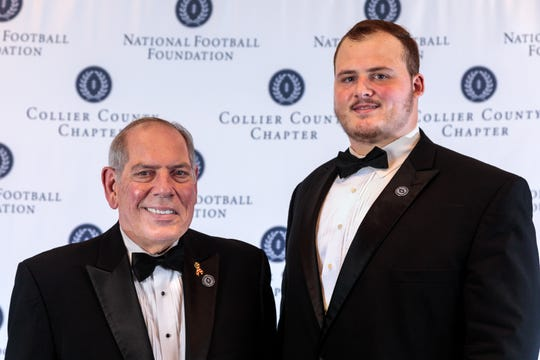 Naples High senior offensive lineman Mike Fangman (right) poses with National Football Foundation Collier County Chapter president Matt Sellitto during the group's annual banquet on Feb. 23, 2020, at the Naples Sailing and Yacht Club.