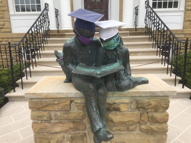 The statues in front of the Granville Public Library, already sporting masks, now have mortar boards in honor of the Class of 2020.