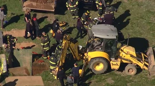 A cemetery worker was trapped knee deep in dirt after a grave collapsed on him Tuesday, May 5, 2020 in Lyndhurst's Hillside Cemetery.