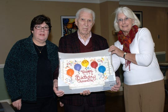 Quentin Wiest with his daughter Lan Kassover (left) and daughter-in-law Betty Weist at the Hobbyist Club meeting celebrating his birthday 100th birthday.