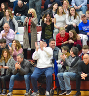 Lori Farquhar, wearing the black sweater and camouflage shirt, celebrating after her son, Andrew Farquhar, of the Emerson/Park Ridge wrestling team, escaped with two seconds left for the win against Kittatinny in the 2020 sectional finals.  Emerson/Park Ridge won the match.