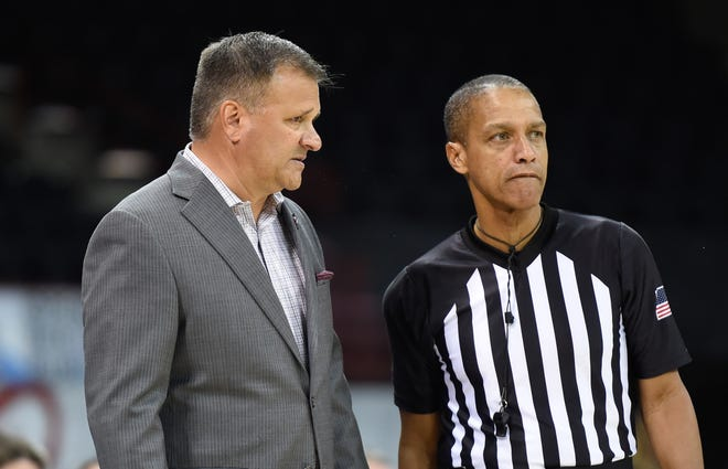 Dec 4, 2019; Spokane, WA, USA; New Mexico State Aggies head coach Chris Jans talks with an official during a game against the Washington State Cougars in the second half at McCarthey Athletic Center. The Cougar won 63-54. Mandatory Credit: James Snook-USA TODAY Sports