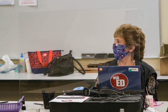 Poll workers wear masks as voters fill out ballots at the Doña Ana County Government Center in Las Cruces on Tuesday, May 5, 2020.
