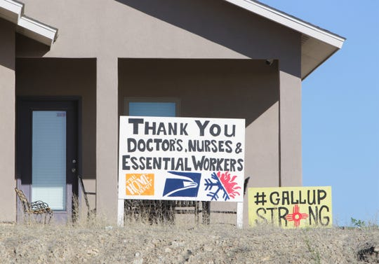 Signs outside a home show support for essential workers on May 4 in Gallup. The city has been on lockdown to mitigate the spread of the coronavirus.