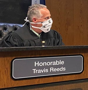 52-1 Judge Travis Reeds in Novi manages a videoconference and the pandemic.