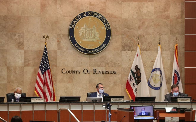 Riverside County Board of Supervisors, from left, Chuck Washington, Manuel Perez and Kevin Jeffries meet and gather information before voting on whether to lift the Covid-19 restrictions in Riverside, May 5, 2020.
