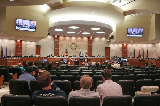 People attend a Riverside County Board of Supervisors meeting where the supervisors are voting on whether to lift the Covid-19 restrictions at the county administration center in Riverside, May 5, 2020.