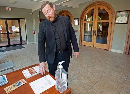 The Rev. Nicholas Schumm, pastor at St. Thomas More Catholic Church, will hold Mass in-person on Wednesday for the first time since the coronavirus caused many churches to suspend in-person services.