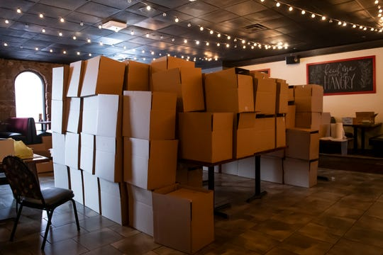 Hundreds of boxes wait to be filled as part of Bourbon's Neighbors Feeding Neighbors food program on Tuesday, May 5, 2020.