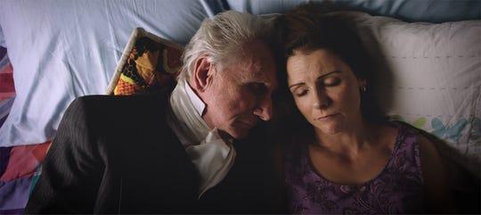 Rene Auberjonois and Amanda Melby in a scene from the film 'Raising Buchanan.'