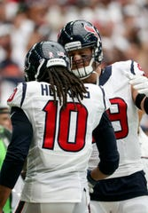 Houston Texans wide receiver DeAndre Hopkins (10) celebrates scoring a touchdown with defensive end J.J. Watt (99).