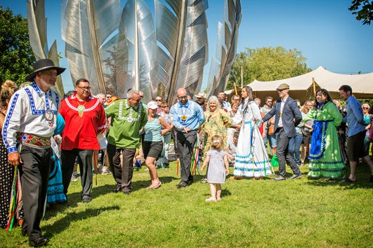"""Choctaw Nation citizens join with residents of Midleton, County Cork, Ireland to dedicate the  sculpture """"Kindred Spirits"""" to honor the Choctaw Nation's support during the potato famine of 1845-1852. The sculpture was dedicated June 18, 2017."""