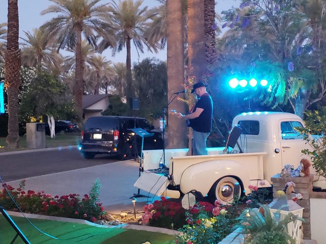 About 150 neighbors gathered, keeping their distance, as musician Harley Davidson warmed up, standing in the bed of a restored 1950 truck backed into Pidgeon's driveway.