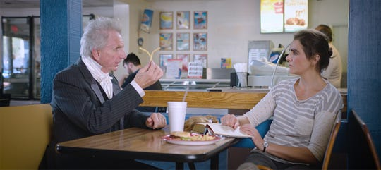 Rene Auberjonois and Amanda Melby in a scene from 'Raising Buchanan.'