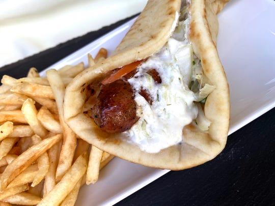 Orange loukaniko sandwich with onions, tomato and tzatziki from Xanthi Greek Food in Avondale.