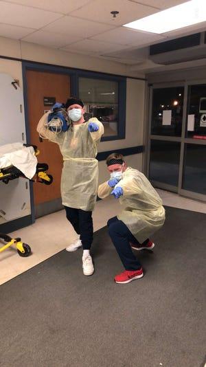 Port Clinton graduates Brock Moore, left, and Eric Christiansen are emergency room nurses in Elyria.