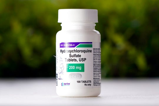 FILE - This Tuesday, April 7, 2020 file photo shows a bottle of hydroxychloroquine tablets in Texas City, Texas. On Friday, April 24, 2020, the U.S. Food and Drug Administration warned doctors against prescribing the malaria drug to treat COVID-19 outside of hospitals or research settings. (AP Photo/David J. Phillip)