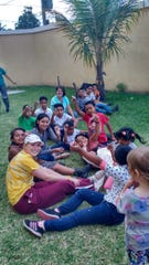 Members of Servants, Inc. work with a group of children in Guatemala during a mission trip in 2018.