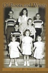 "Julie Swope's book, ""Of Roots and Wings,"" from 2012 tells the story of her life up to 2009, before she faced a life-altering diagnosis. The photo on the book's cover is taken on the steps of a Pennsylvania orphanage with Swope (bottom right) standing with her brothers and sisters. She was Beverly Stauffer at that time, the day she was adopted by new parents. They changed her name to Julia DiMedio."