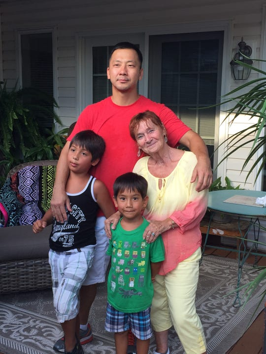 Julie Swope (left) with her son, Dae Jin, and grandsons Evan and Liam.