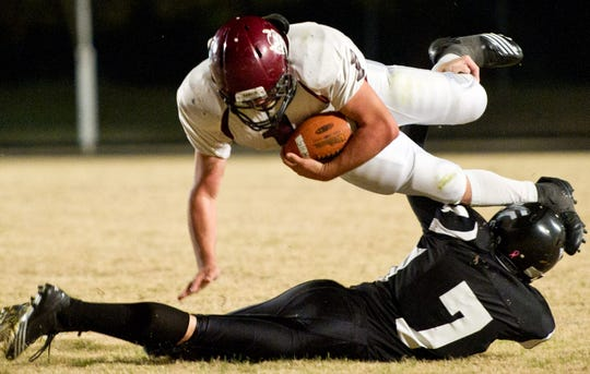 Water Valley's Zach Glass (7) upends Rankin's Ryan Thomas in a first-round playoff game in 2010.