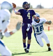 Sterling City's Tate Horwood (4) throws a pass against Richland Springs in the 2010 state final.