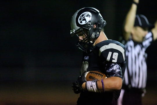 Water Valley's Devan Glass scores a touchdown in the second quarter of the Wildcats' game against Grady in 2014.