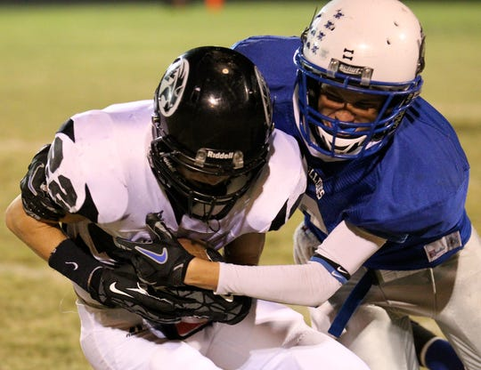 Water Valley's Trae Hannon is tackled by Eden's Patrik Gloria in a 2012 game.