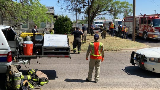 Three fire trucks, four police units and around 20 firefighters responded to a house fire in the 1900 block of North Oakes Street on Wednesday, May 5, 2020.