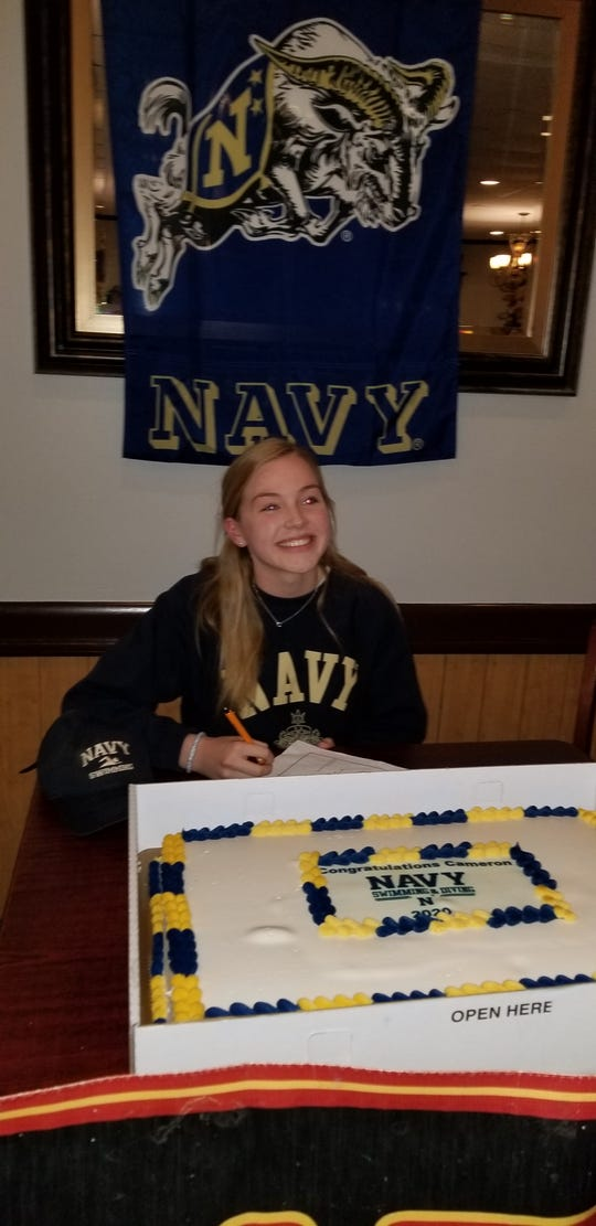 Cameron Horner signs her national letter of intent to continue her swimming career at the United States Naval Academy.
