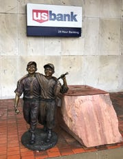 """Day at the Park,"" a bronze sculpture that's part of the Sioux Falls SculptureWalk collection, sits off its pedestal Tuesday, May 5, 2020, after someone damaged the piece the night before, police said. The art is worth $24,000."