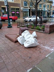 """Protection,"" a sculpture part of the Sioux Falls SculptureWalk lays in pieces Tuesday, May 5, 2020, in front of Lucky's Bar in downtown Sioux Falls after someone damaged the artwork the night before, police said. The sculpture was worth at least $16,000."