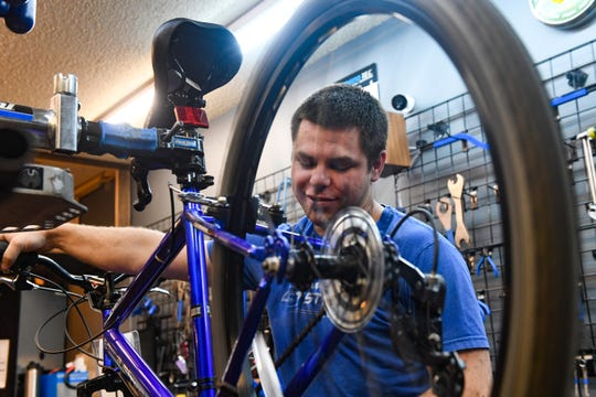 Alonzo Christensen works on bicycle repairs on Tuesday, May 5, at Spoke-N-Sport in Sioux Falls. The shop has seen a significant increase in orders as people find ways to enjoy the outdoors while social distancing.