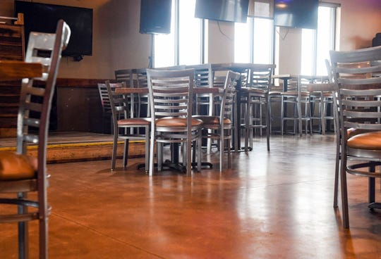 Tables in the dining room are placed 6 feet apart to comply with a new ordinance for business operation during the pandemic on Tuesday, May 5, at Shenanigans in Sioux Falls.