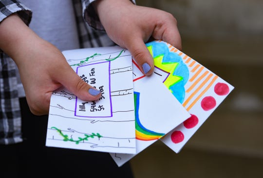 Emerson Weber, 11, holds specially decorated envelopes to send on Tuesday, May 5, at her home in Sioux Falls.