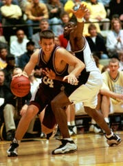 SMS's Kevin Ault drives past Missouri's John Woods during the first half of SMS's NIT victory over Mizzou. Ault led the Bears with 24 points.