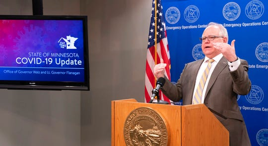 Governor Tim Walz speaks during a press conference Tuesday, May 5, 2020 with MMB Commissioner Myron Frans to discuss the State of Minnesota's budget projection. The state's budget outlook crumbled from a $1.5 billion surplus to a projected $2.4 billion deficit in just two months, as the COVID-19 pandemic eats up tax revenue and Minnesota leaders accelerate spending to respond.   (Glen Stubbe/Star Tribune via AP)