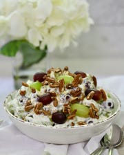 Easy grape salad is more of a dessert with cream cheese and sugar dressing.