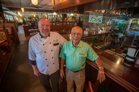 Chef Grant Beane and Georgio Koikos, owner of Georgio's Fine Food and Spirits, pose for a photo on Tuesday, May 5. Georgio's will be serving food inside and on the veranda  for Mother's Day.