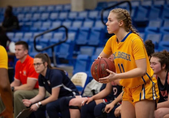 TCC guard Olivia Eller looks to make a pass during a game inside the Eagledome.