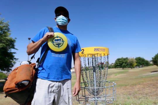Vic Villalobos, president of the El Paso Disk Golf Club, talks about the disc golf course still under city lockdown since the baskets used for the sport are considered playground equipment, Tuesday, May 5, at Travis White Park in El Paso.