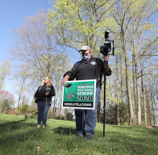 Photographer Bob Castner, right, sets up a portrait of the Tinari family on Tuesday, May 5, 2020.