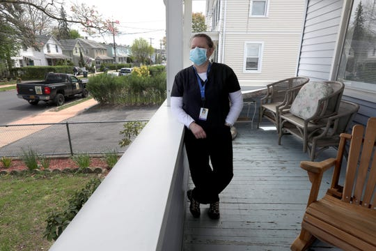 Joann Warner, a registered nurse with Visiting Nurse Services of Westchester, Inc., goes into coronavirus patientsÕ homes on a daily basis as part of a job. Warner, photographed in Port Chester May 5, 2020, says that she sees COVID-19 patients towards the end of her day, after she has seen non-COVID patients so as not to potentially infect those that don't have the virus. Before entering the home of someone with COVID-19, she dons a full set of PPE, including a gown, face shield, and hair covering.