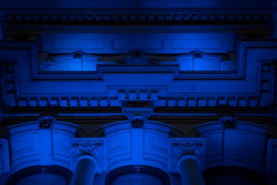 Blue lights illuminate The Grand Opera House in honor of first responders on the front lines of the coronavirus pandemic Monday, May 4, 2020, on Market Street in Wilmington.